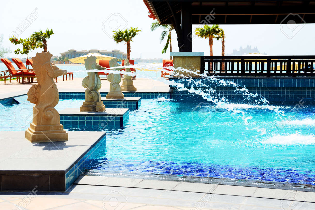The swimming pool near beach in Thai style hotel on Palm Jumeirah..