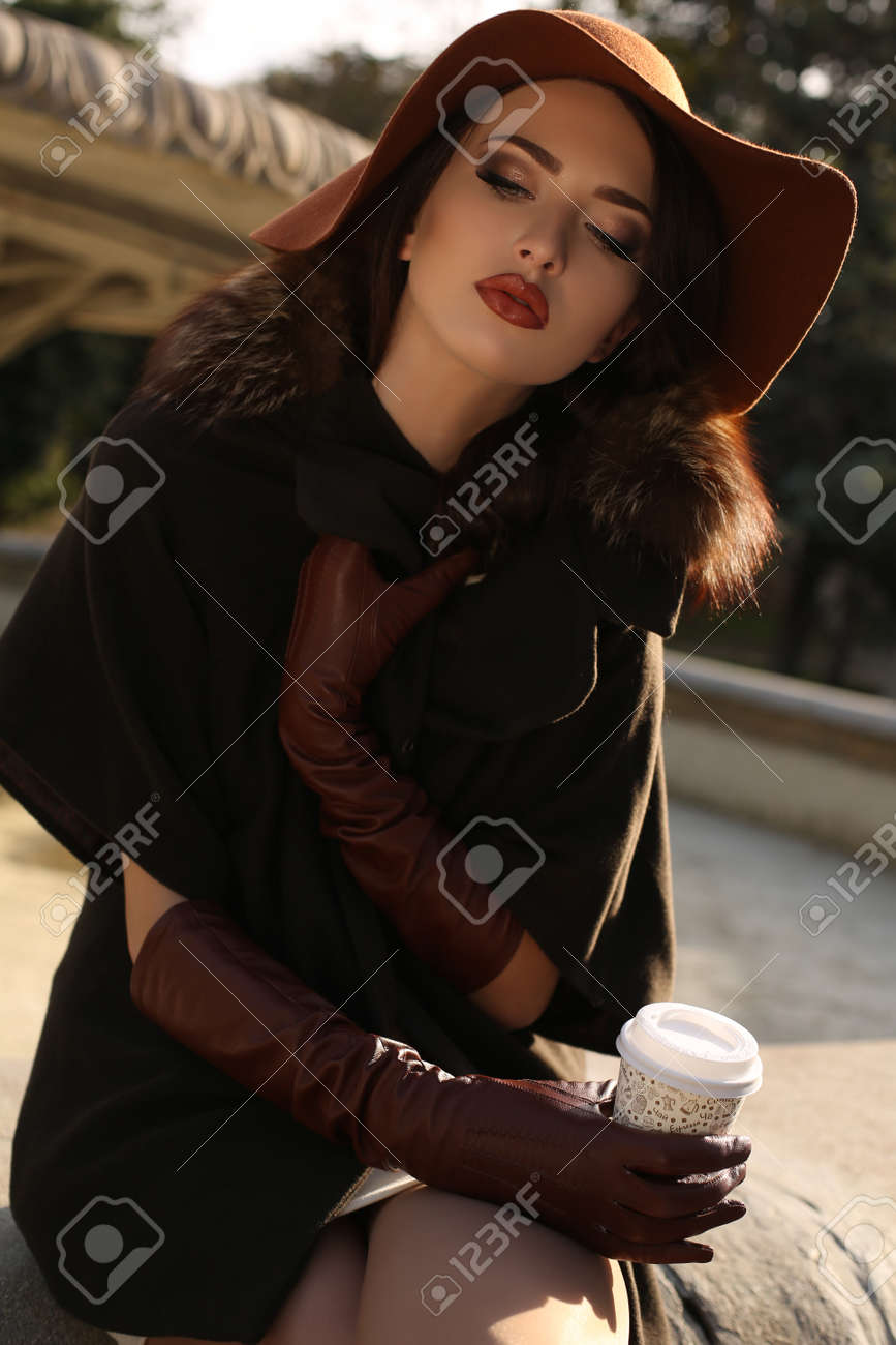 fashion outdoor photo of beautiful ladylike woman wearing elegant