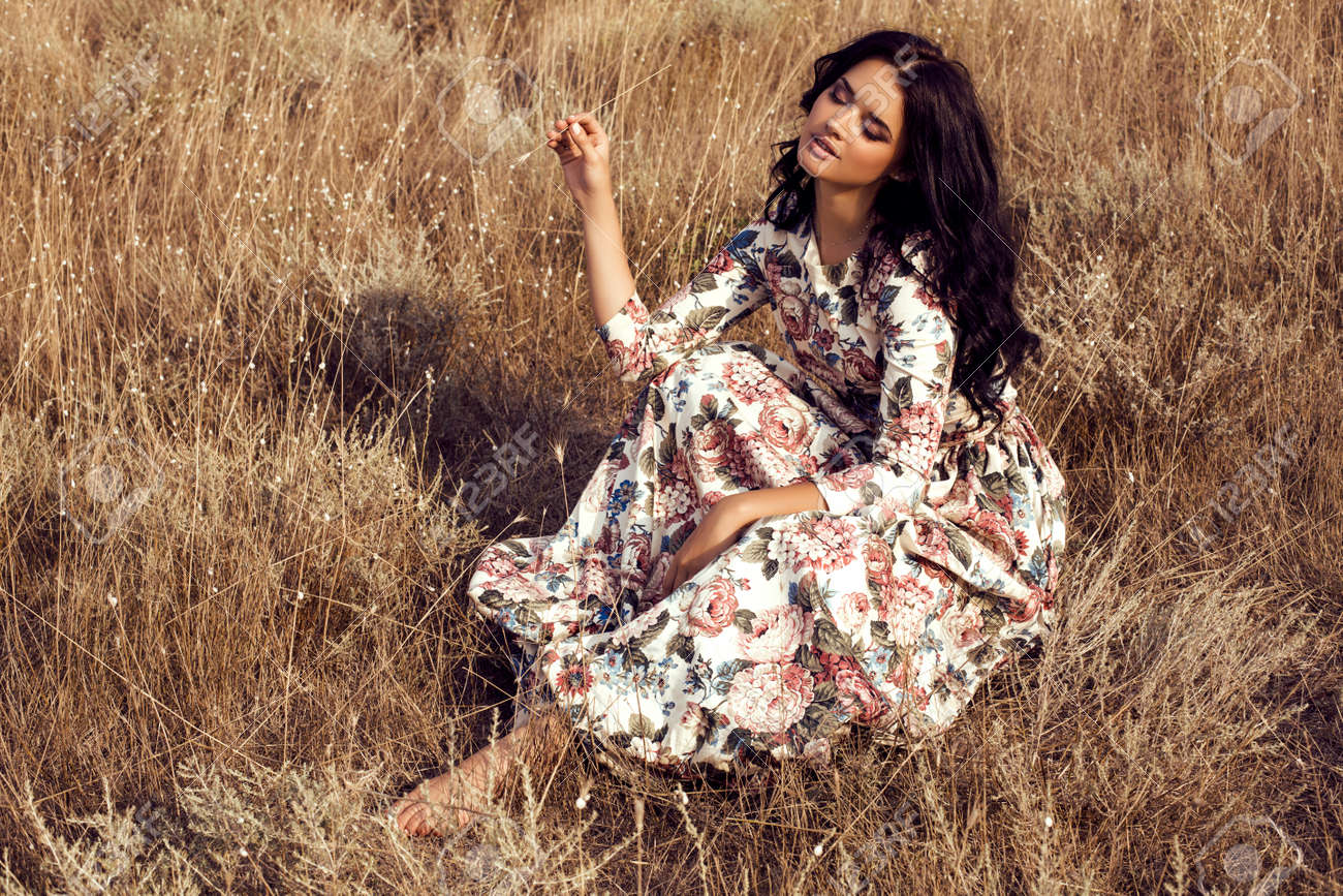 Fashion Outdoor Photo Of Beautiful Sensual Woman With Dark Hair Wears Luxurious Colorful Dress Flowers