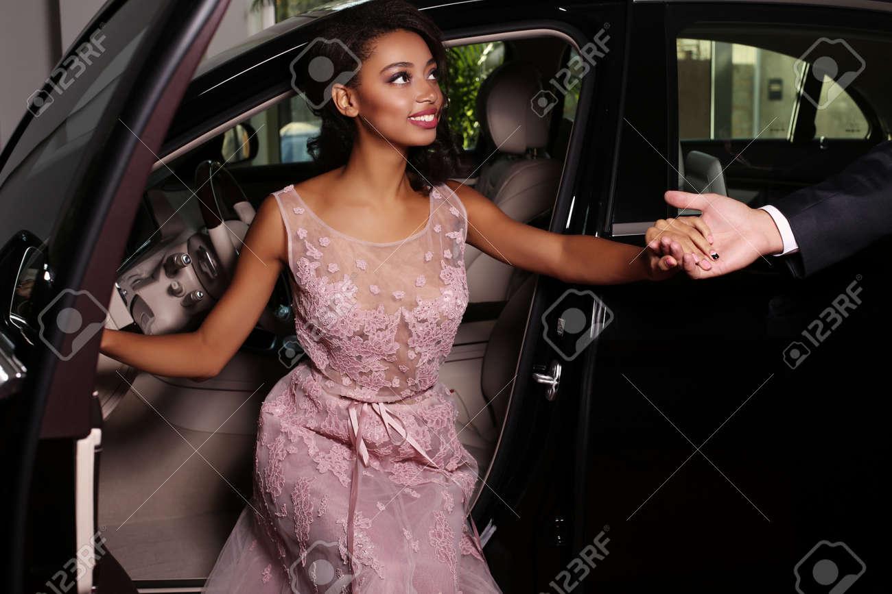 9b309688bec fashion photo of gorgeous mulatto woman with long dark hair wears luxurious  dress