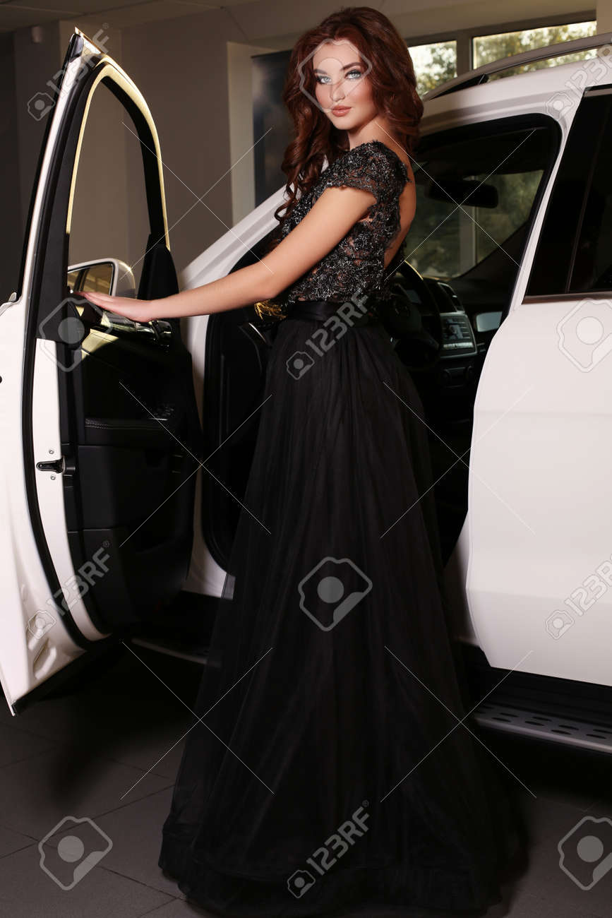 8dedff7d4f2 fashion photo of gorgeous woman with long dark hair wears luxurious dress