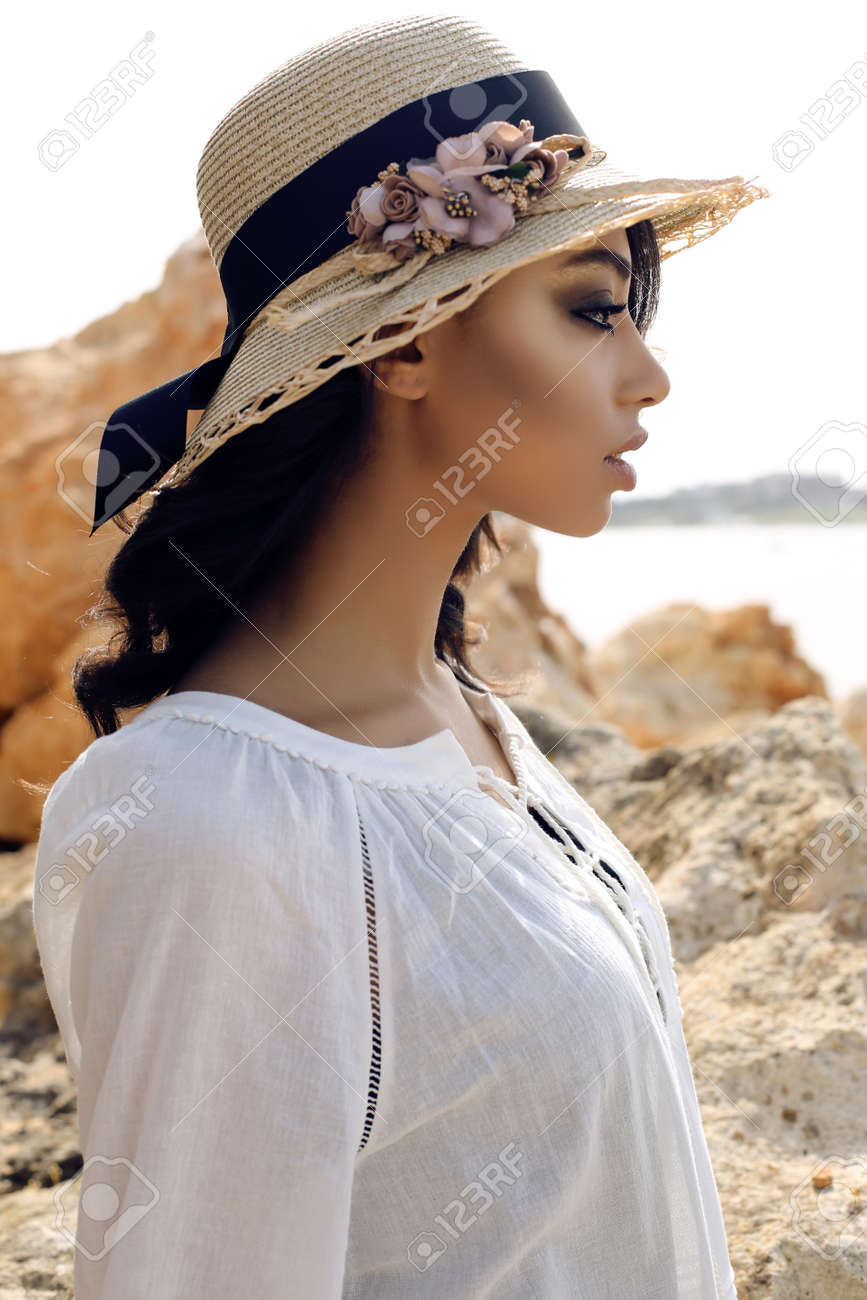 1264c1591a9 fashion outdoor photo of beautiful girl with dark hair wears casual elegant  clothes and hat posing