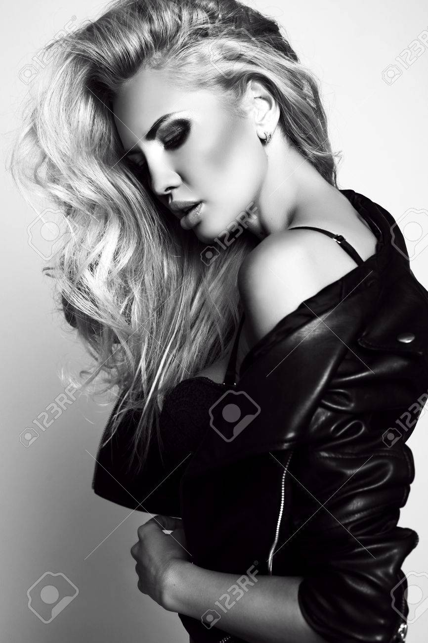 Fashion black and white studio photo of gorgeous sexy woman with