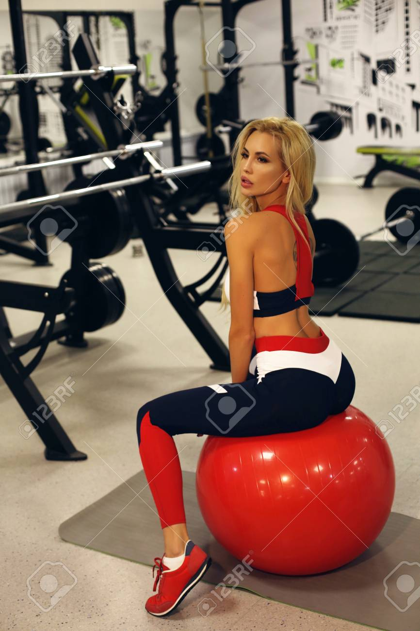 fashion photo of sexy woman with blond hair in sports clothes training in  gym Stock Photo 08f58b4c29f2