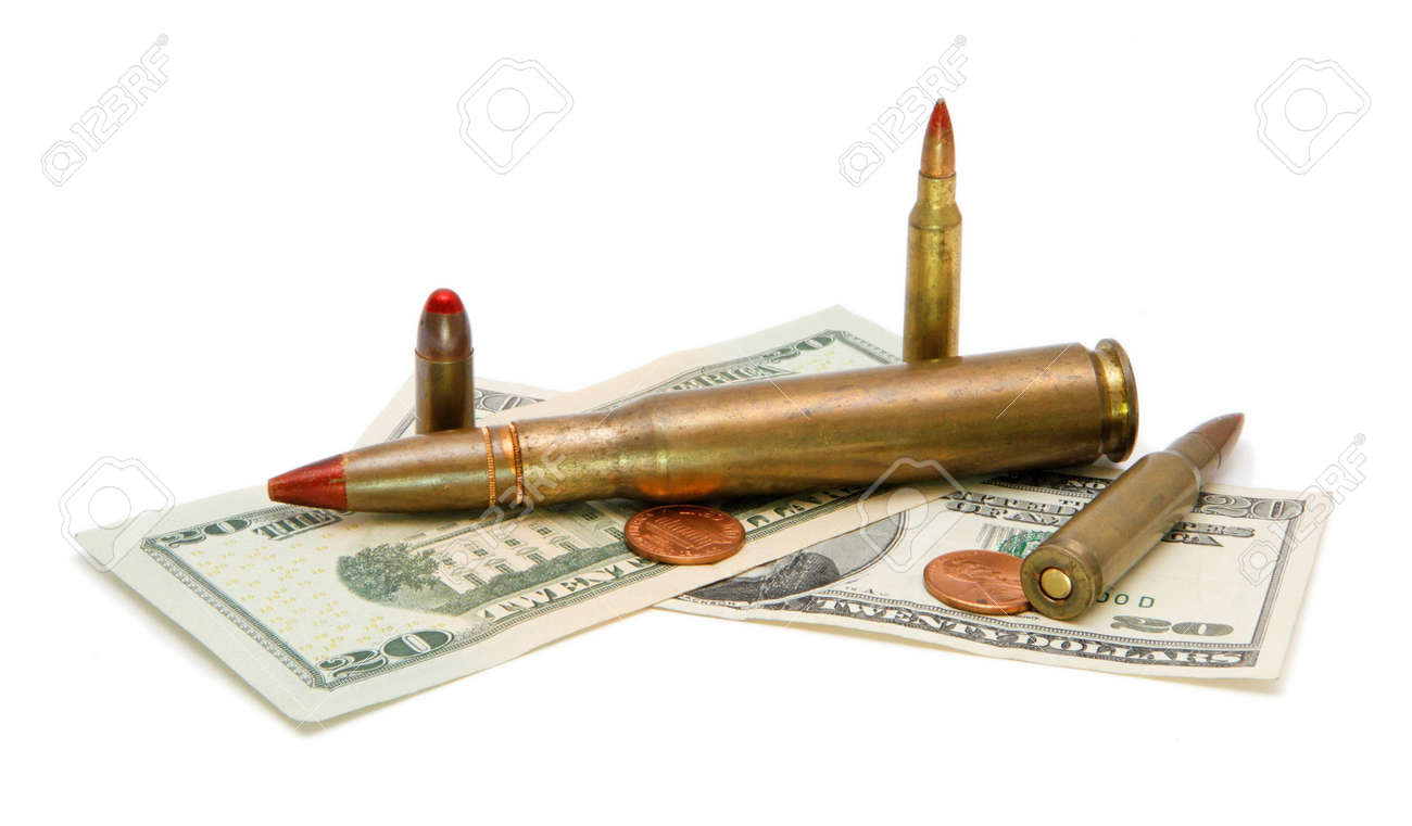American banknotes, coins and tracer cartridges on white background Stock Photo - 4722949