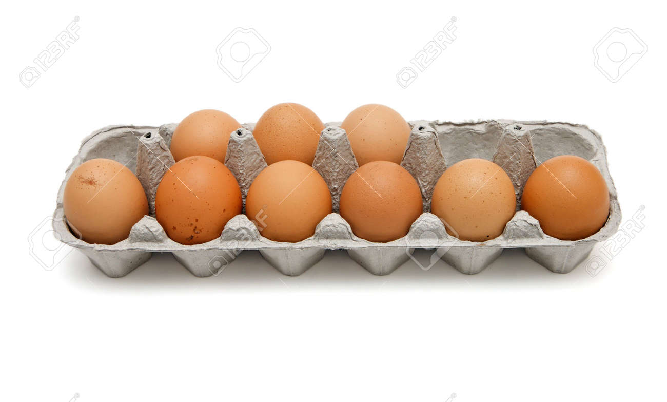 Nine brown eggs in a paper box isolated Stock Photo - 4955059