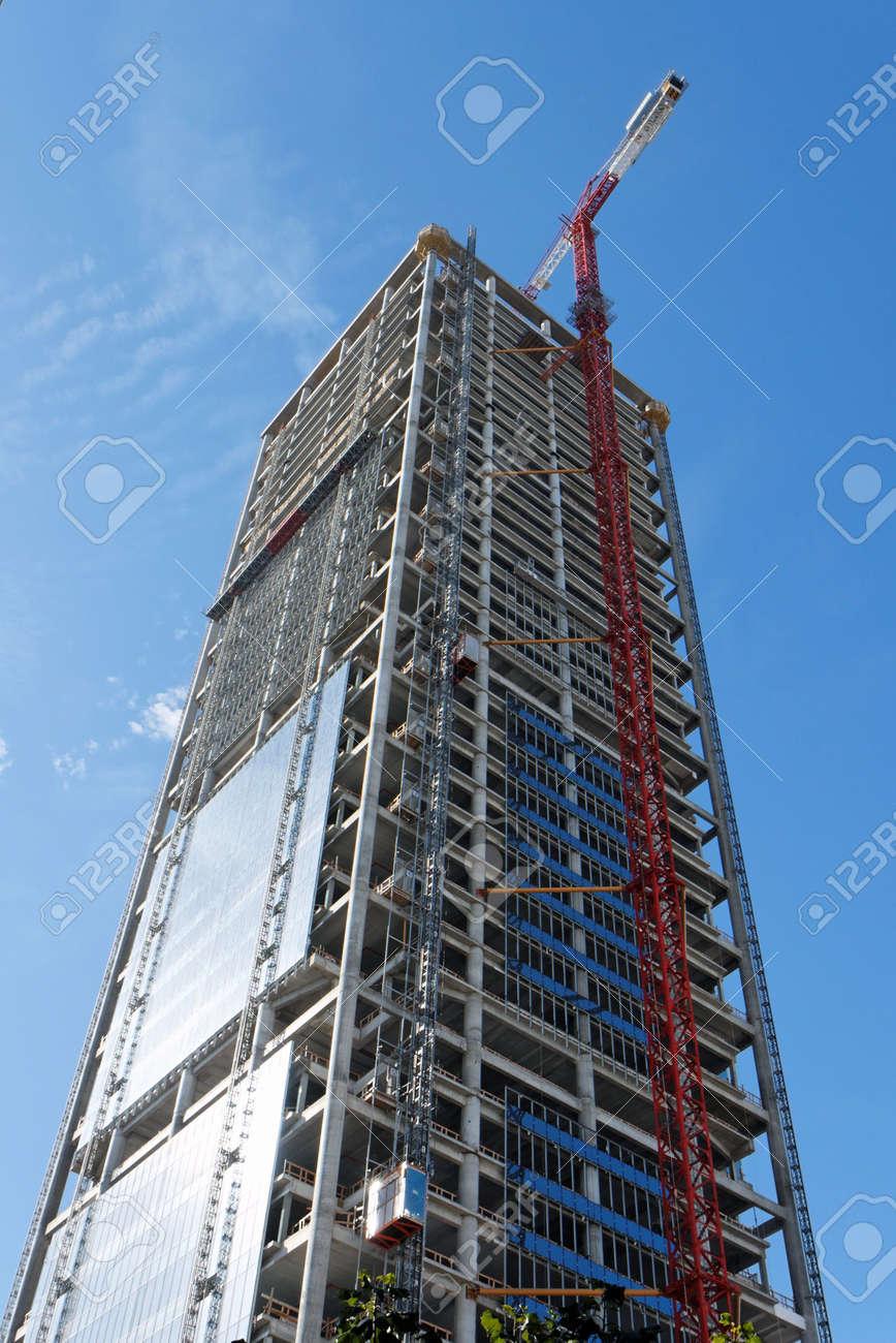 Lifting crane at skyscraper construction site Stock Photo - 6593050