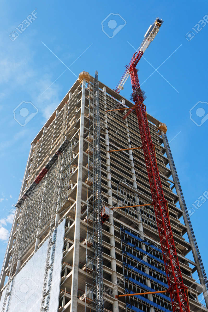 Lifting crane and high building under construction Stock Photo - 12378236