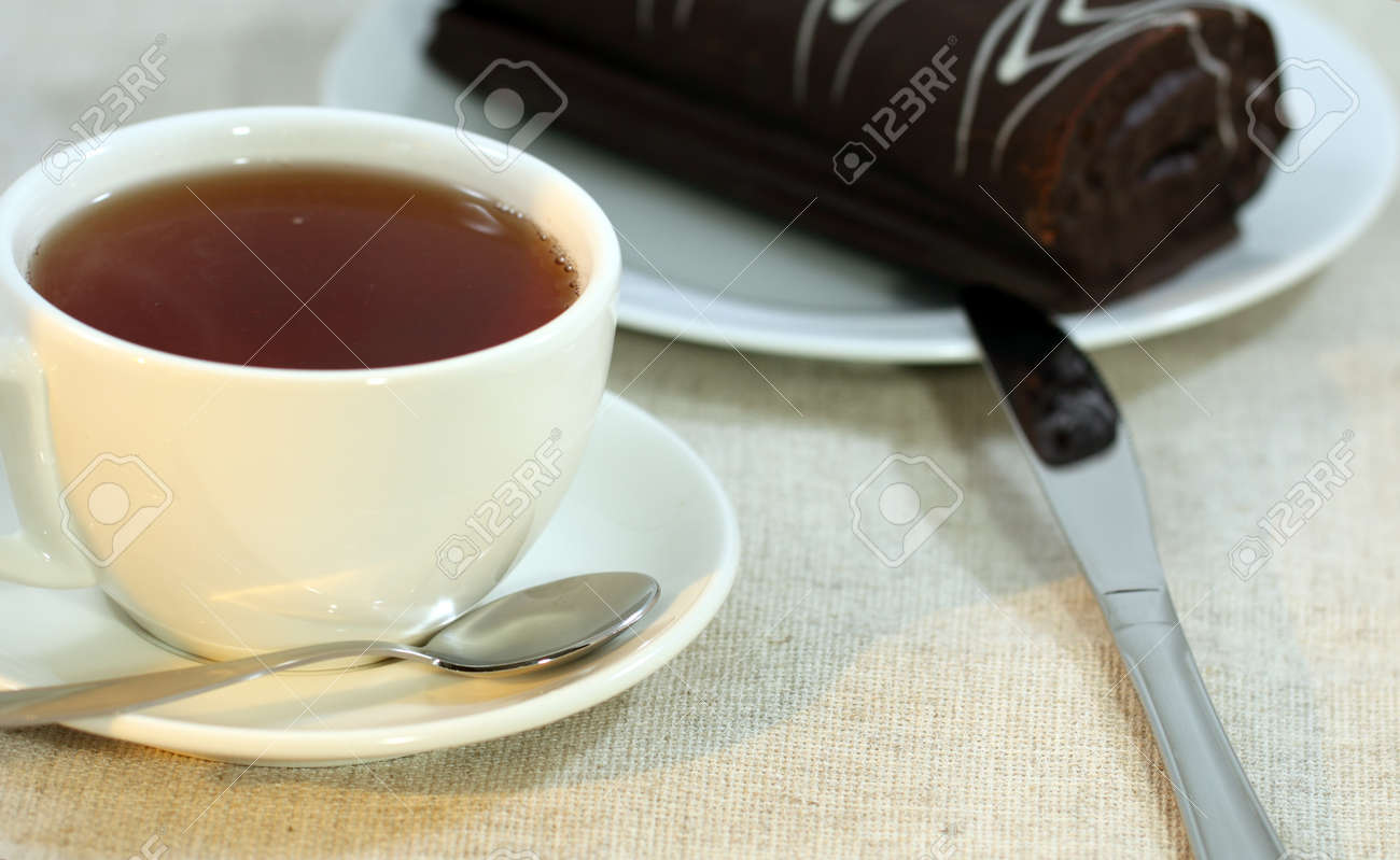 Breakfast In The Form Of A Cup Of Tea On A Saucer, A Chocolate ...