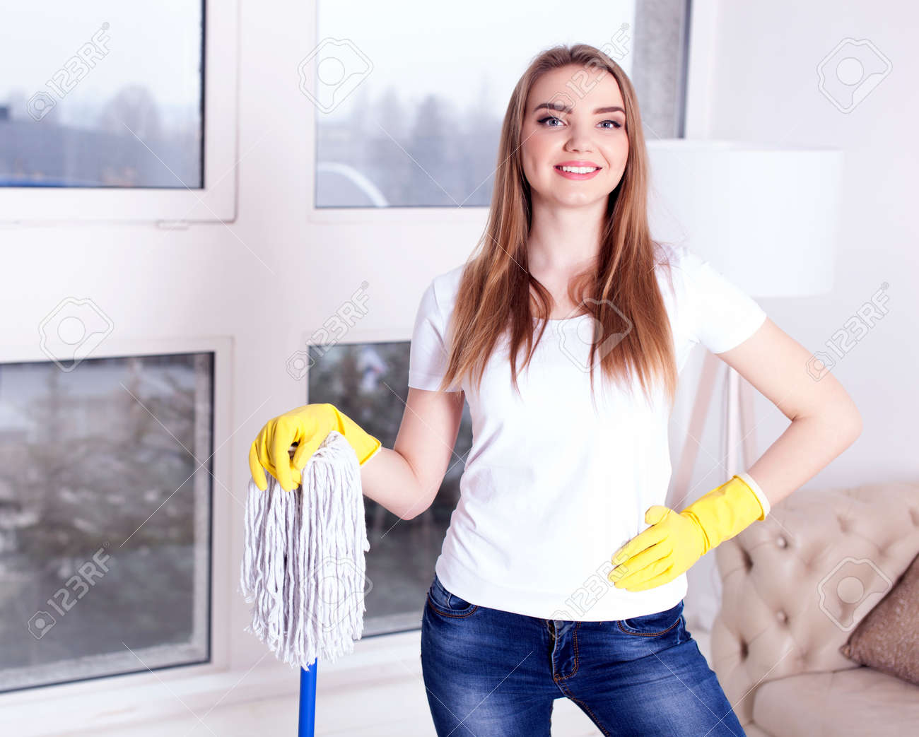 Young woman housewife with mop. Portrait - 75270602