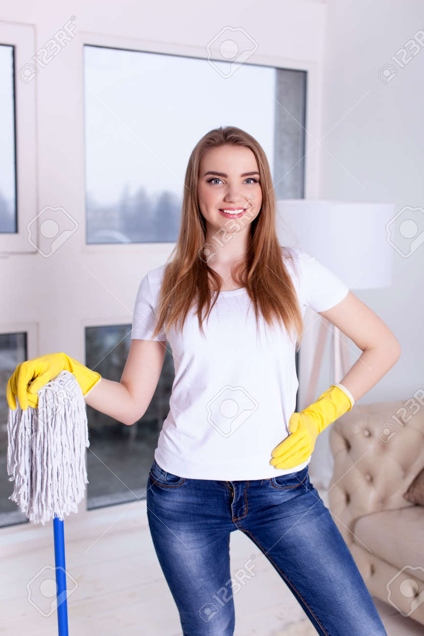 Young smiling woman housewife with mop. Portrait - 75270603
