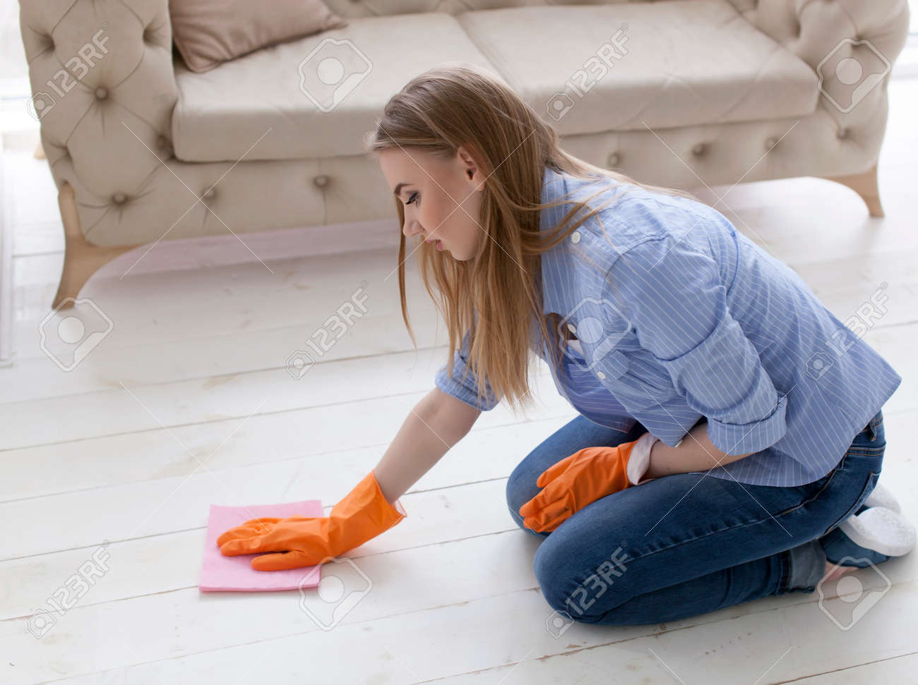 Attractive woman housewife cleans floor with brush - 75270607