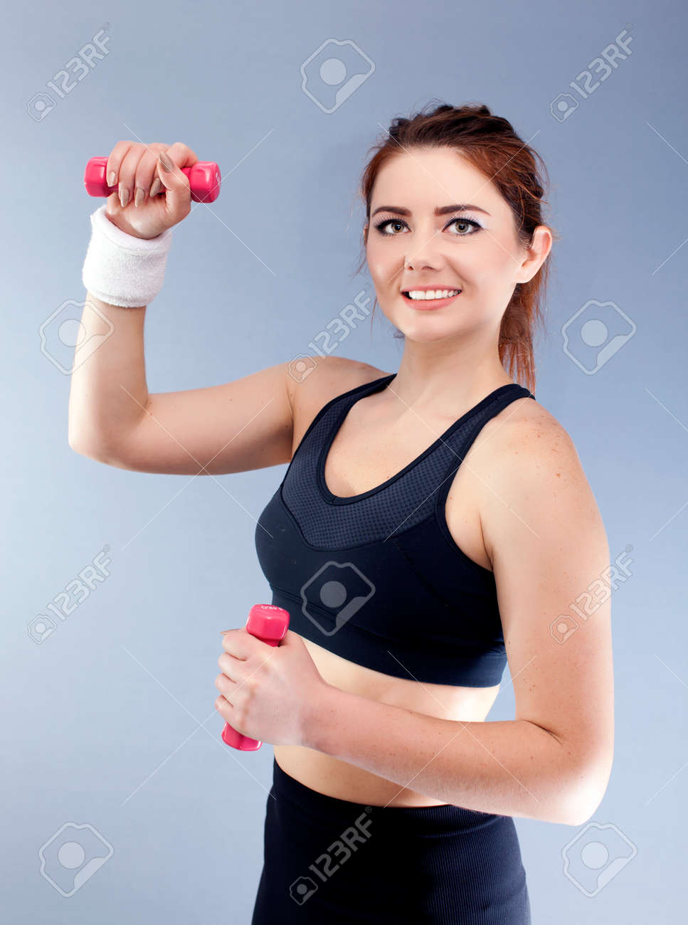 Sport woman with red dumbbells and towel smile, looking in camera. - 75276928