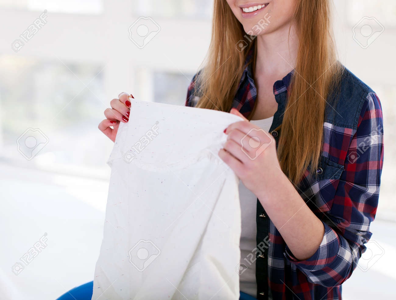 Happy young woman with towel in hands smile.Cropped image - 78032506