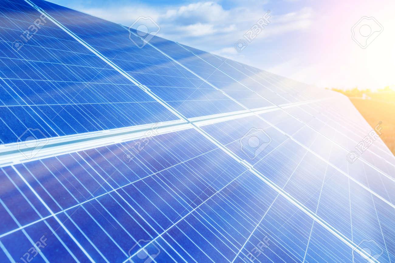 Solar panels, photovoltaic, alternative source environmentally friendly energy. In the backlight sunbeam light. - 165693633
