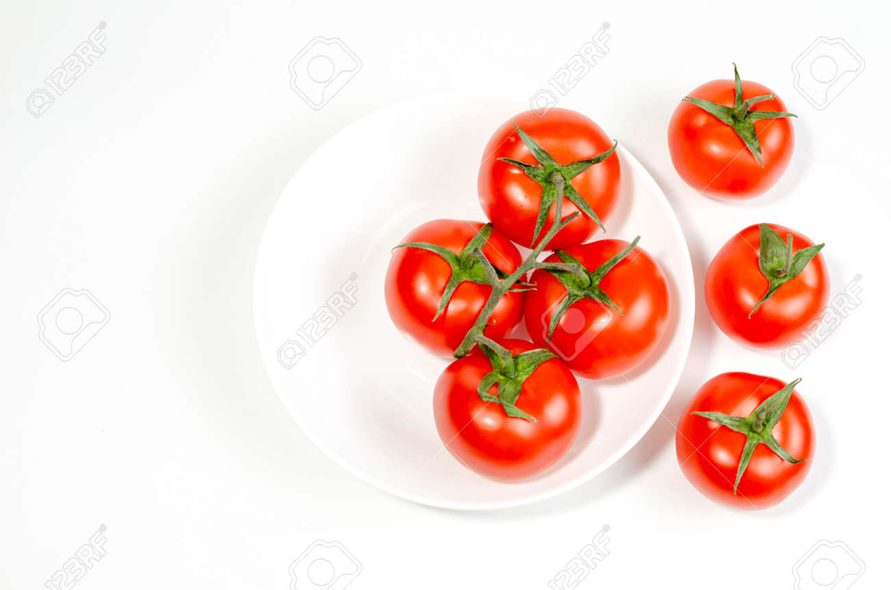 red tomatoes in a shallow plate on a white background. close-up - 149867389