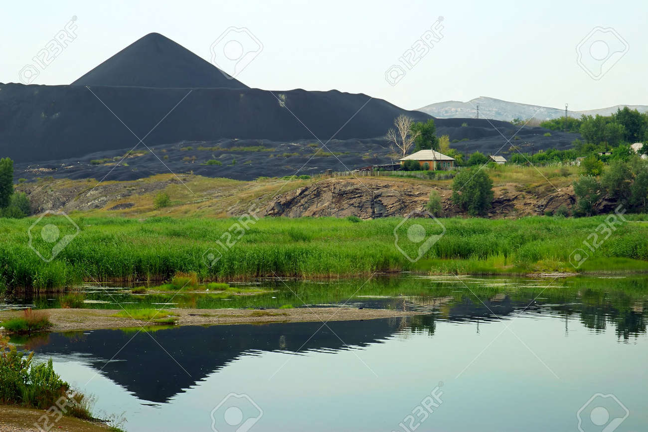 marsh and the black mountains of slags in Kazakhstan, Asia Stock Photo - 4709773