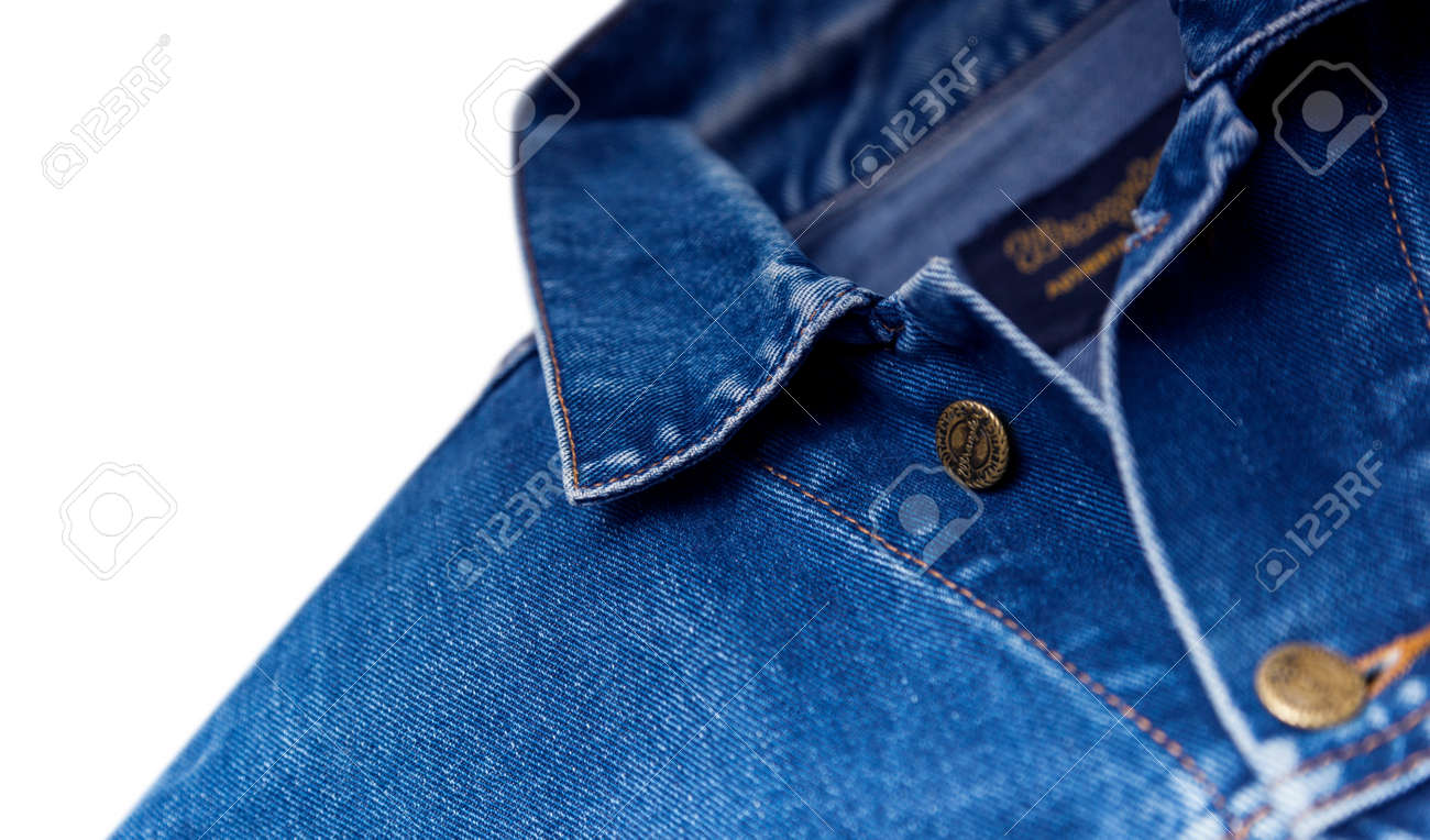 55b0e2b8 CHISINAU, MOLDOVA - December 25, 2017: Jeans jacket Wrangler blue color,  isolated on white background. The Wrangler brand is owned by VF Corporation  of ...