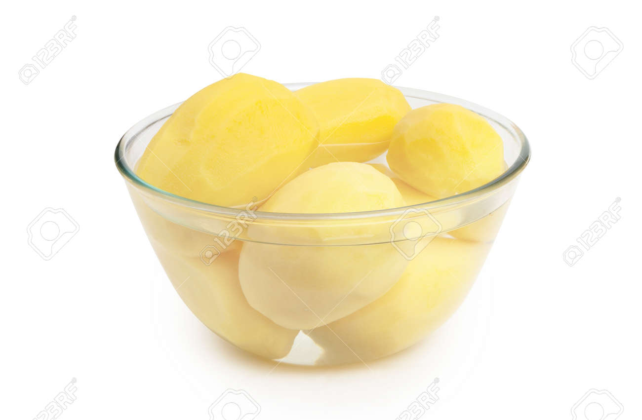 Peeled potatoes in a glass bowl isolated on white background. - 167240274