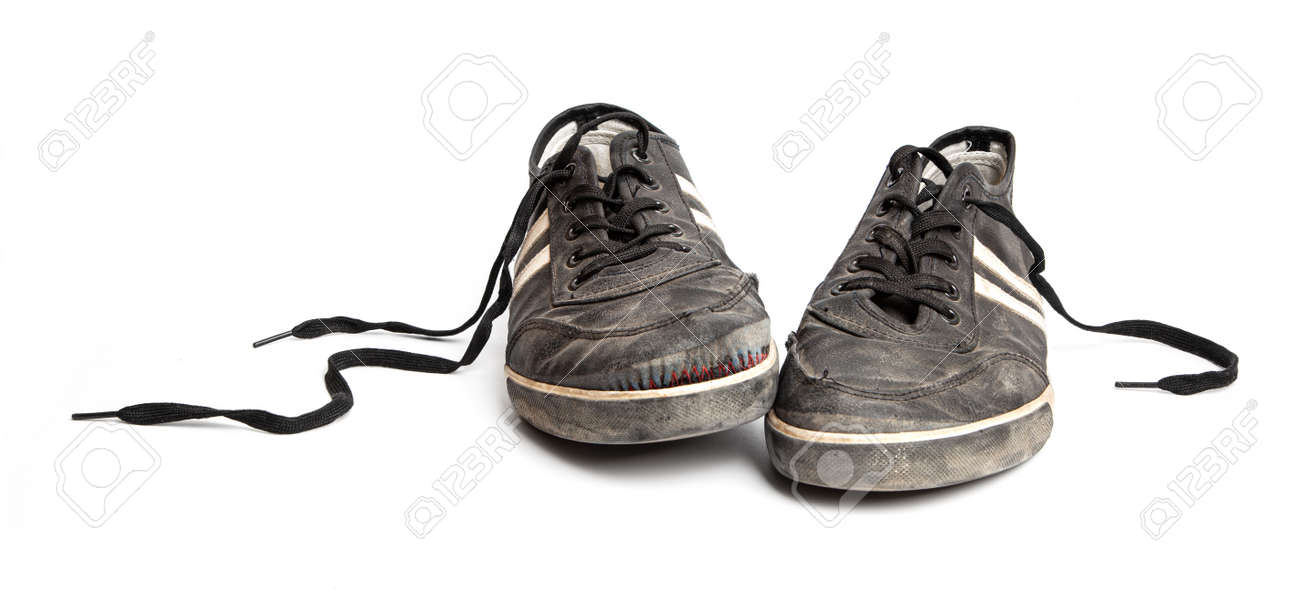Dirty old black sneakers isolated on a white background - 170242790