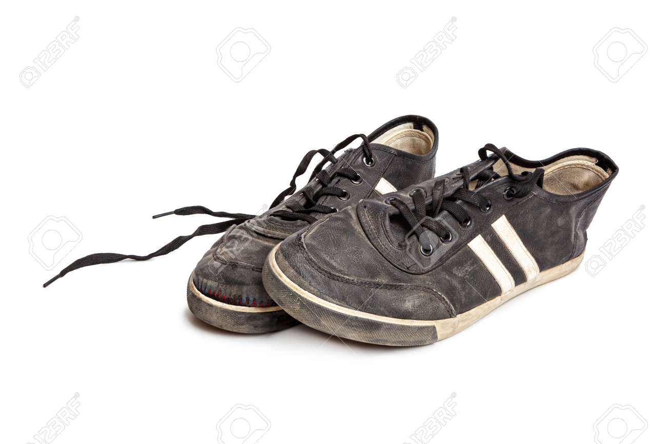 Dirty old black sneakers isolated on a white background - 170242793