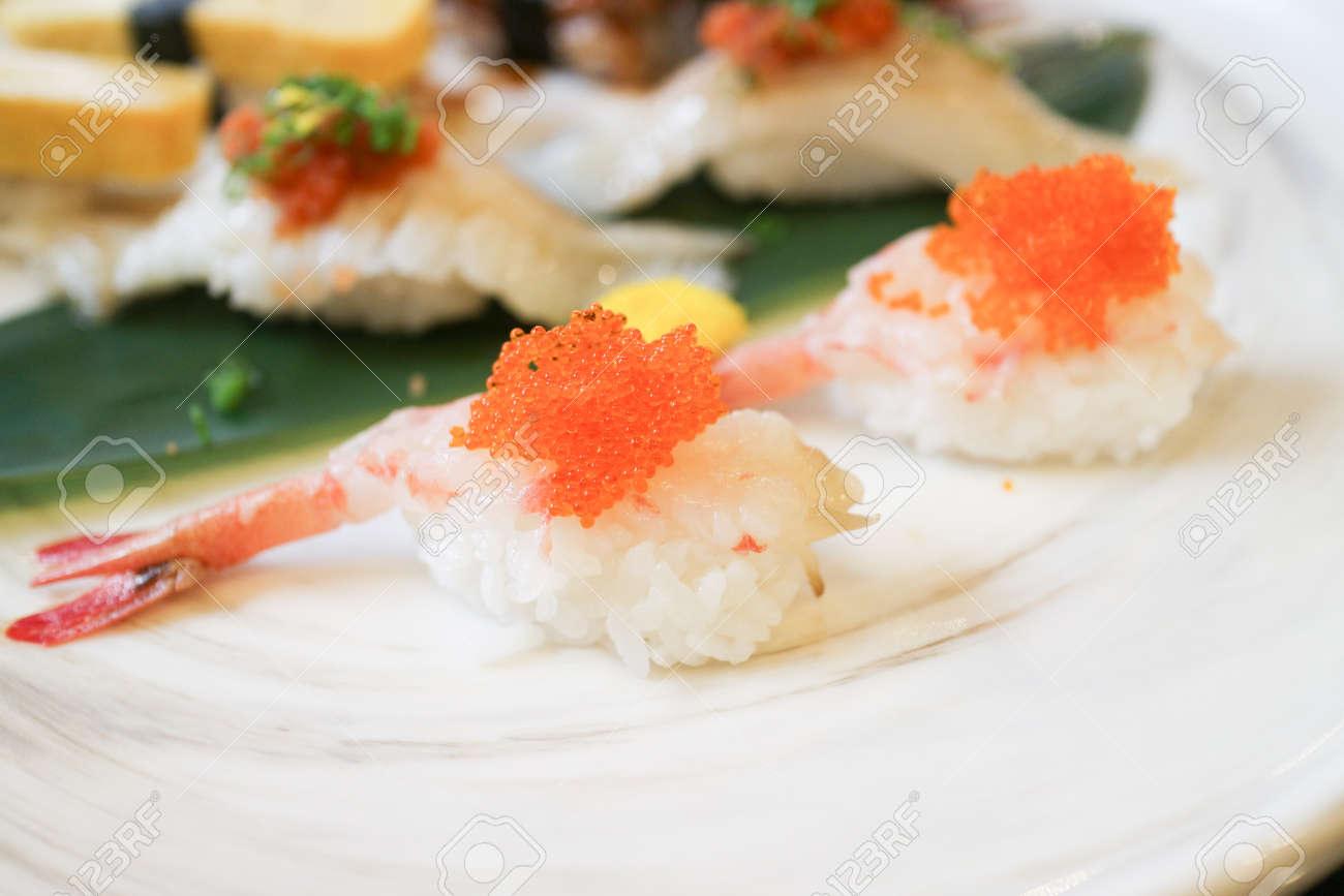 shrimp sushi with orange fly fish eggs on top