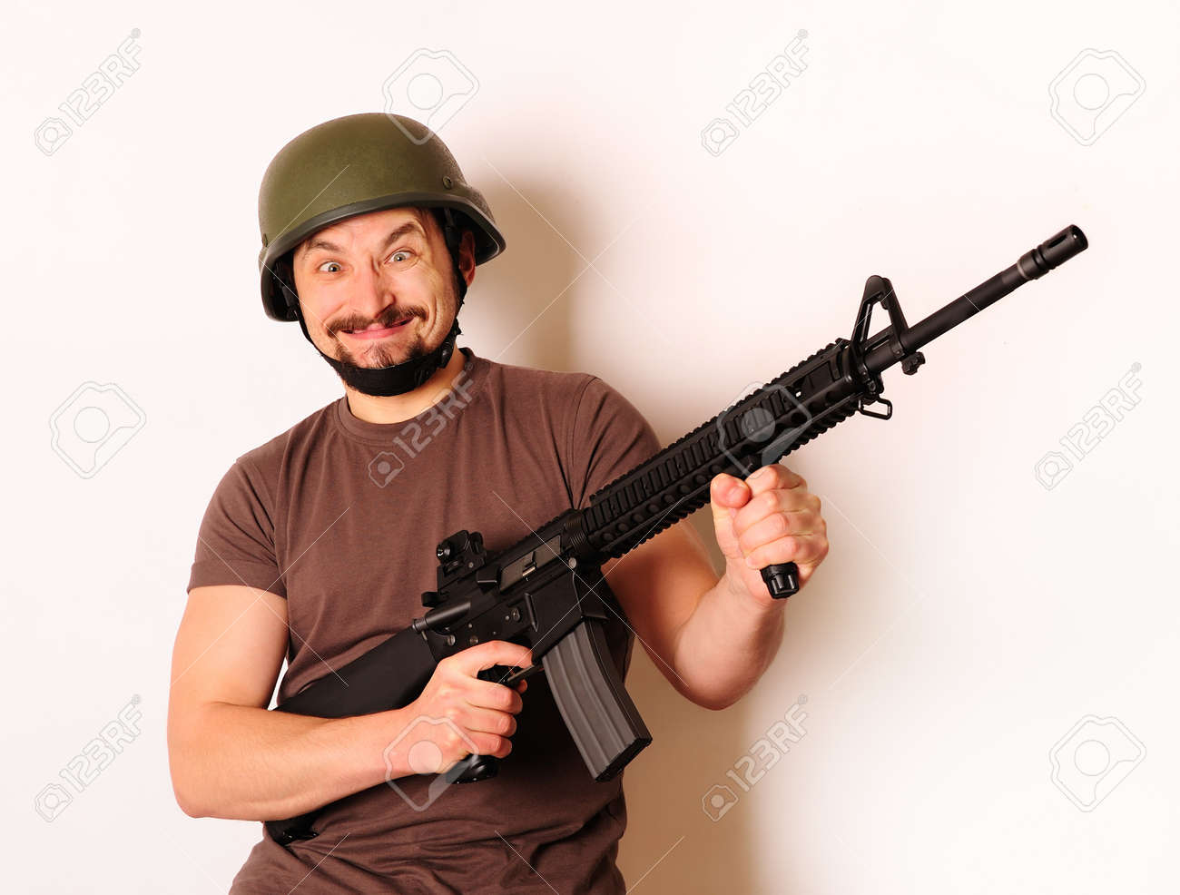 Mad armed man in protective cask Stock Photo - 7066685