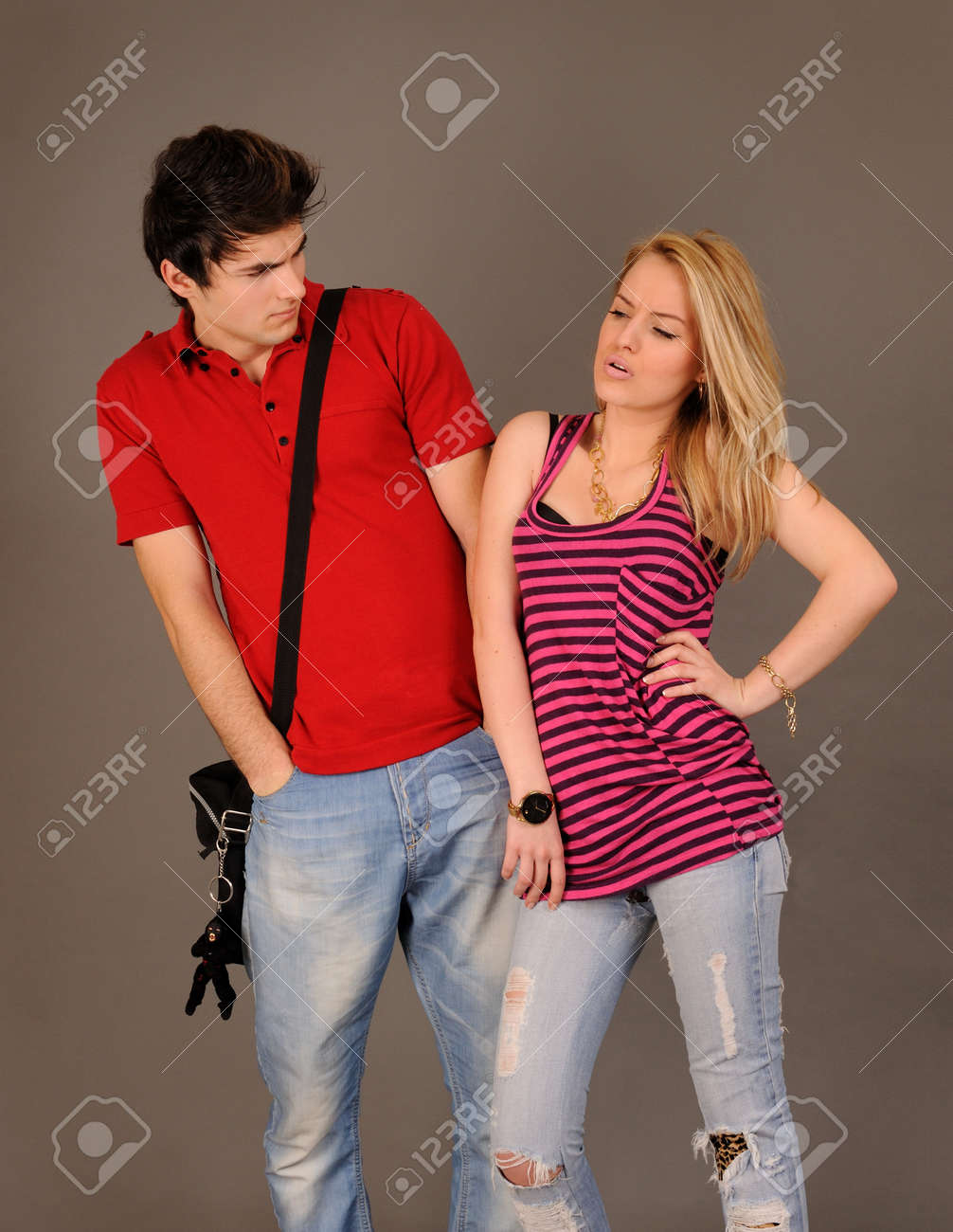 Portrait of an angry couple against gray background. Stock Photo - 8669056