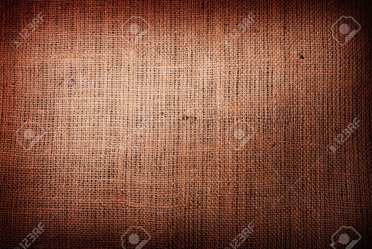 Fragment of rough brown textile background Stock Photo - 9059539
