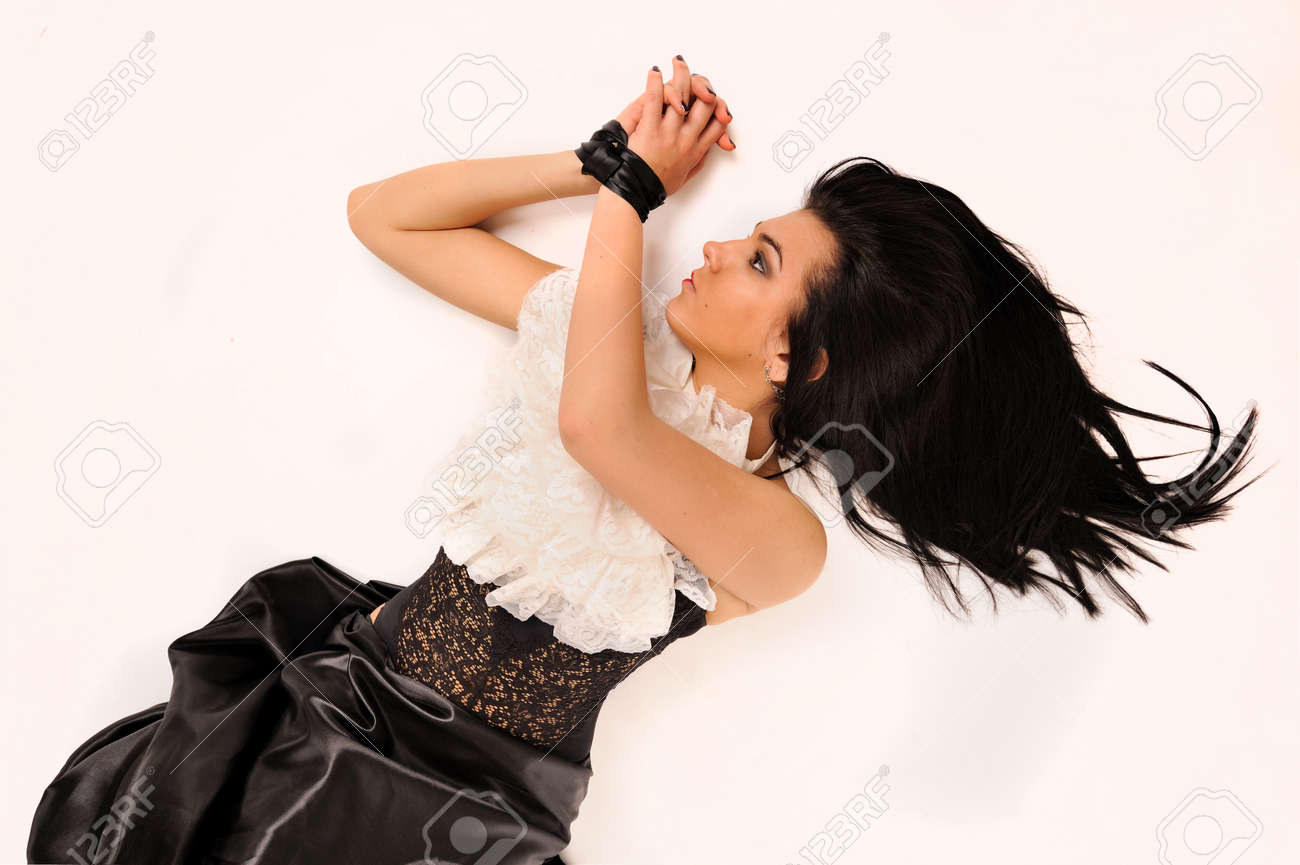 Attractive binding by silk ribbon woman laying on white. Stock Photo - 24384115