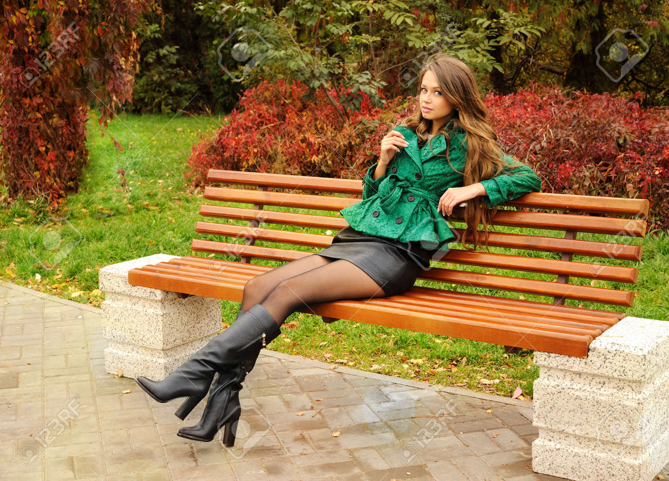 Girl sitting on a bench 4