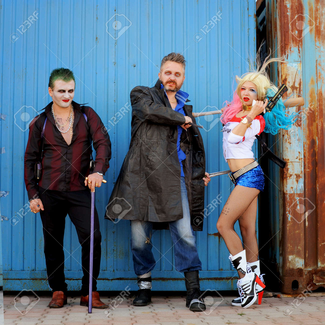 Cosplayer girl in Harley Quinn costume and cosplayer men in Joker and Boomerang costumes Stock Photo  sc 1 st  123RF.com : girl joker costumes  - Germanpascual.Com