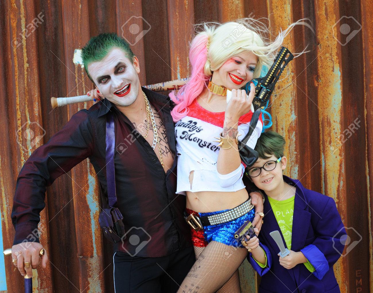 Halloween Joker And Harley Quinn Costumes.Cosplayer Girl In Harley Quinn Costume And Cosplayer Men In Joker