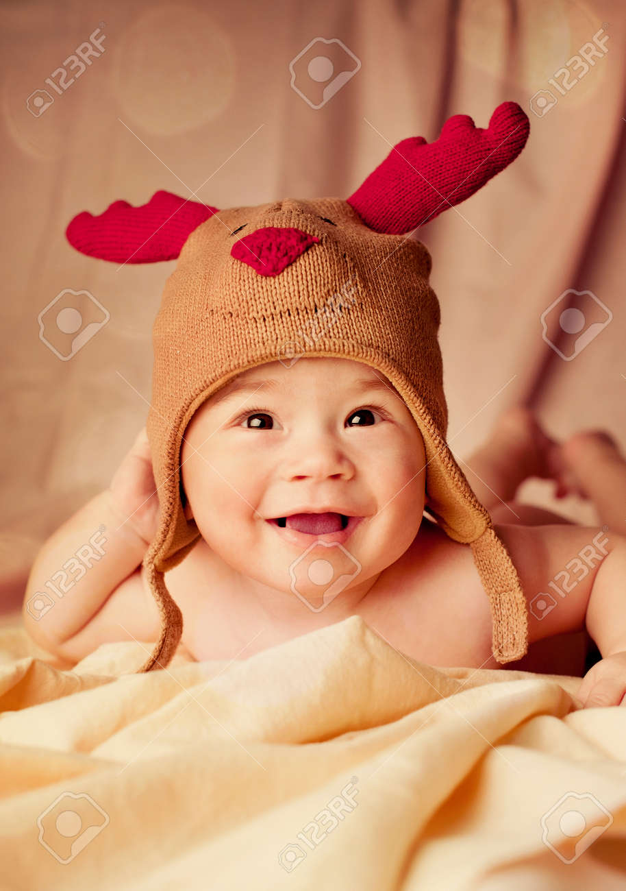 f8ad316d73b Happy smiling infant baby boy portrait dressed in christmas deer crocheted  hat