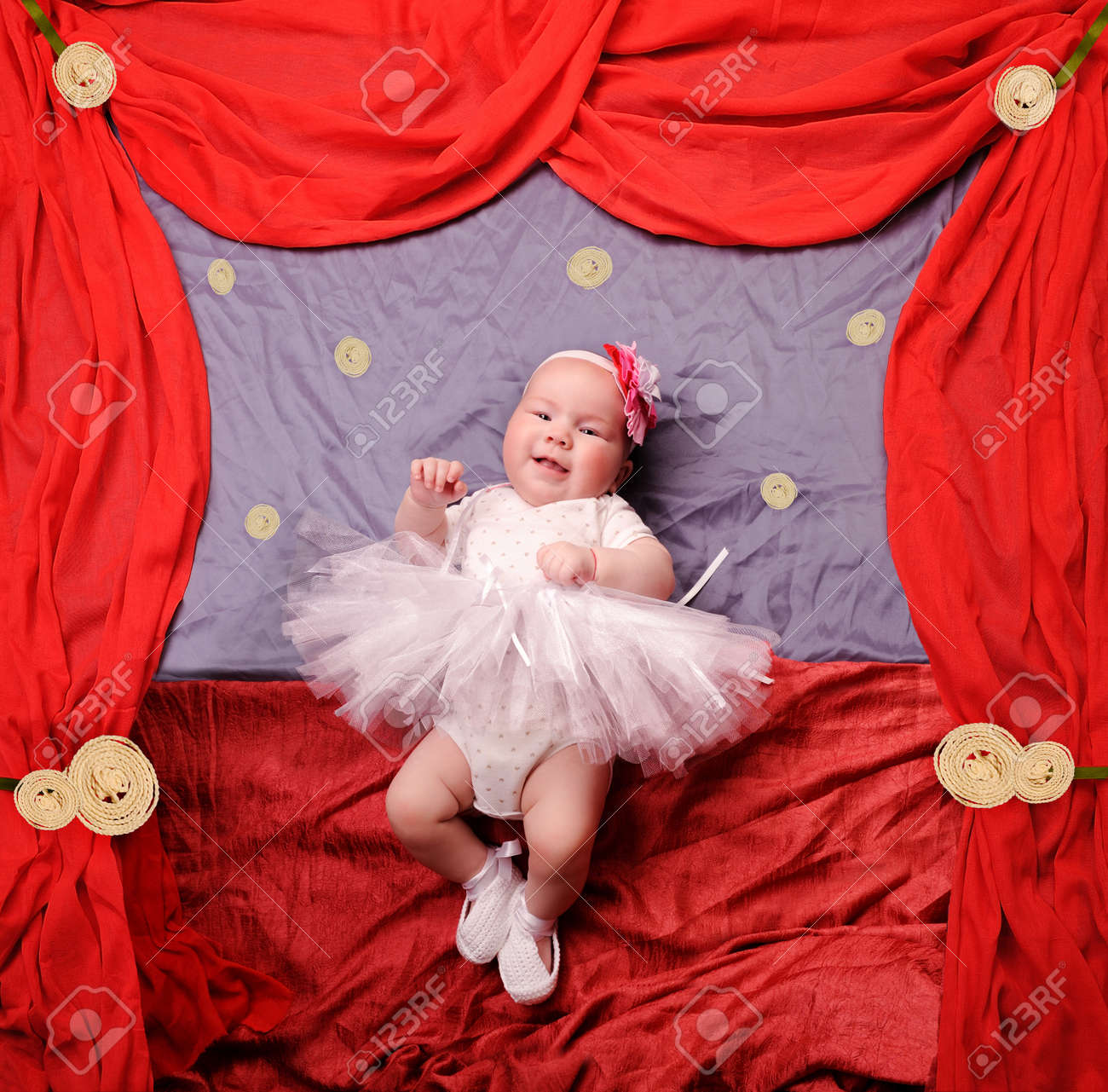 f425a482dc Infant baby girl wearing white ballerina tutu and crocheted ballet slippers,  dancing on a stage