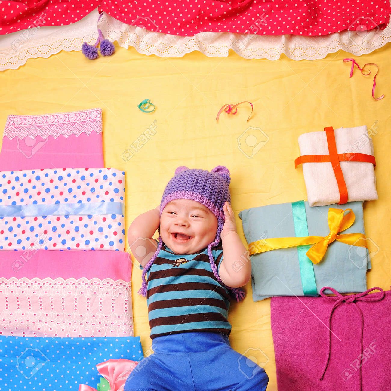a6ebc172cdf0 Smiling Baby Boy Celebrate His First Birthday And Enjoy His Gifts ...