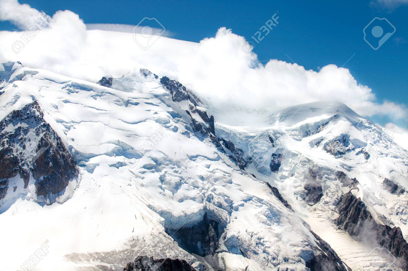 French Alp mountains covered in fresh white snow. Mountaineering, travelling. - 135353220