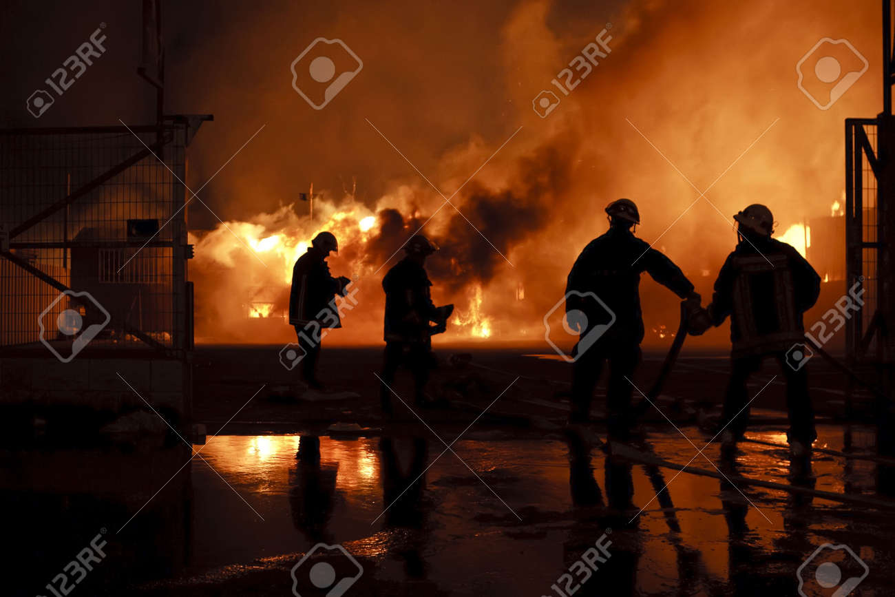 Silhouette of firefighters Stock Photo - 6864040