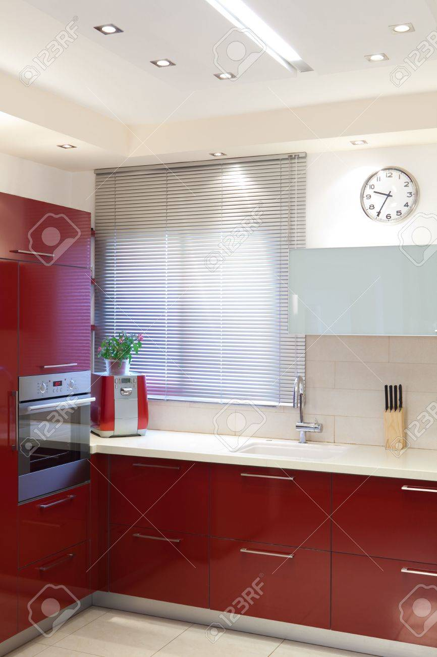 Luxury kitchen with red and marble elements Stock Photo - 7380546