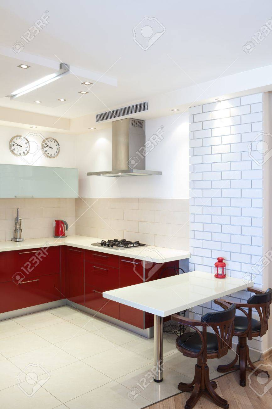 Luxury kitchen with red and marble elements Stock Photo - 7380528