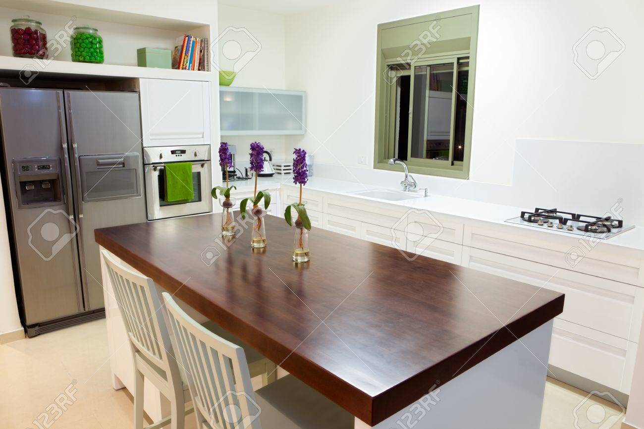 ... Modern Design Kitchen With White And Wood Elements Stock Photo ... On  Custom Kitchen ...