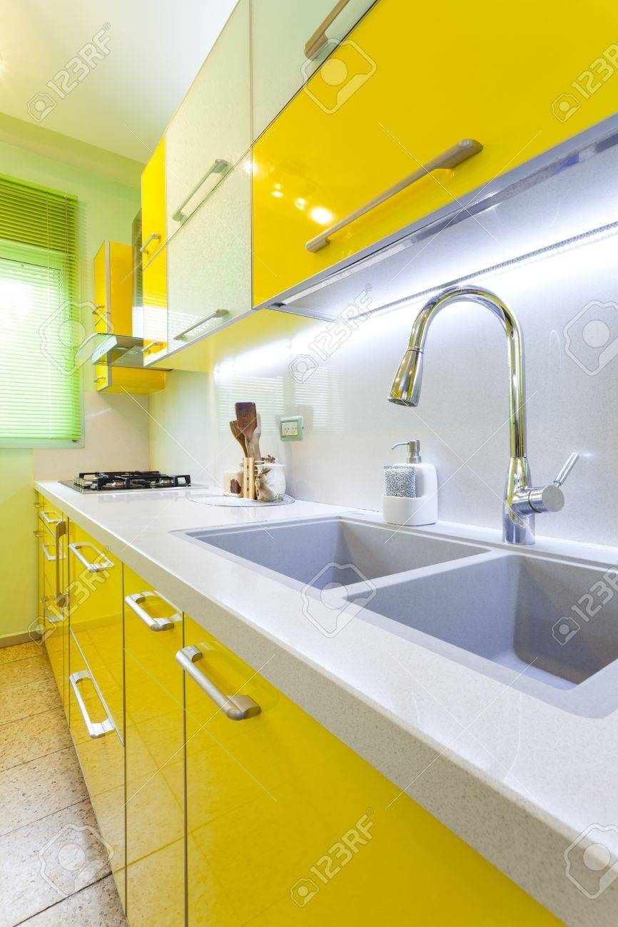 Modern design kitchen with yellow and green elements Stock Photo - 14447212