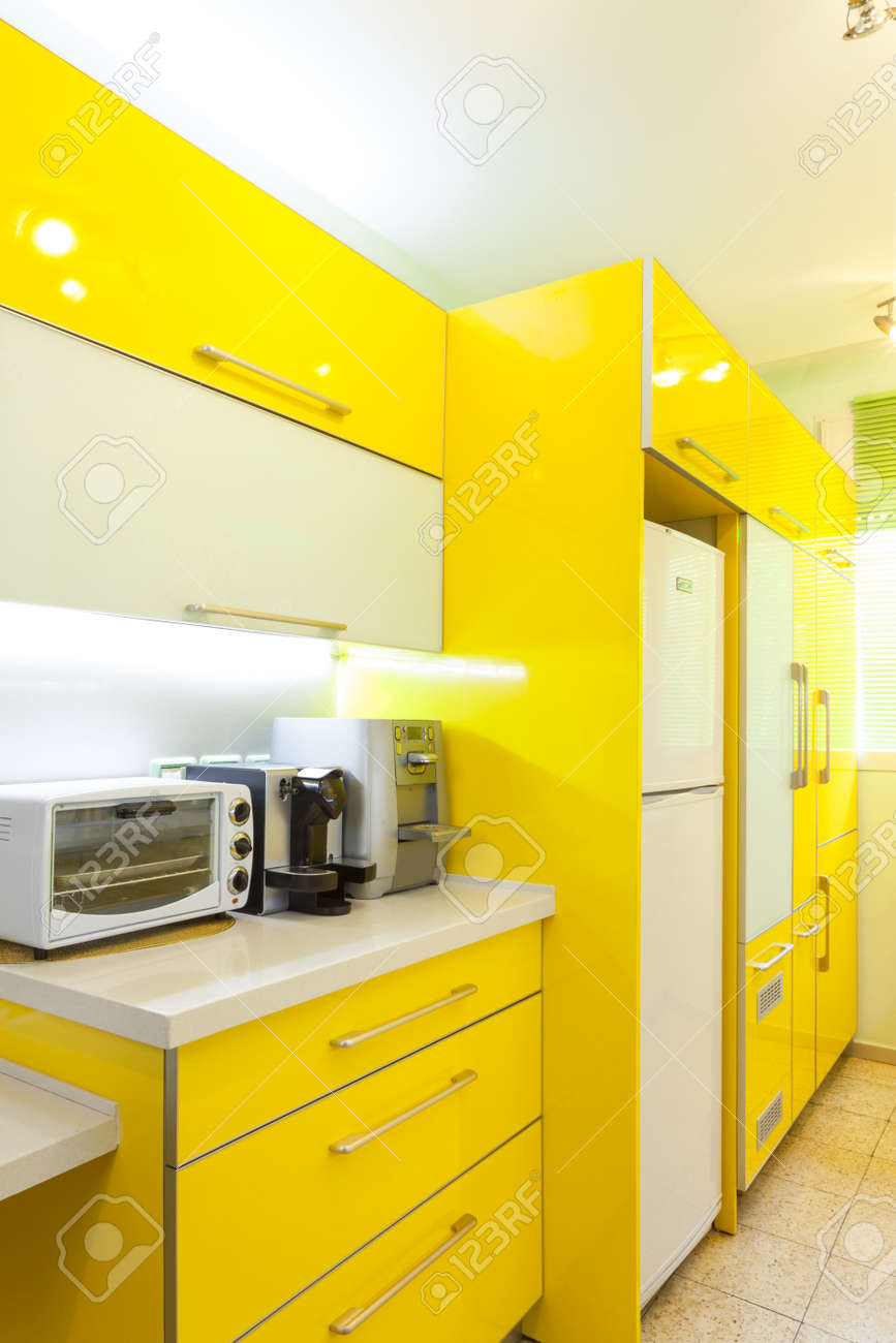 Modern design kitchen with yellow and green elements Stock Photo - 14447187
