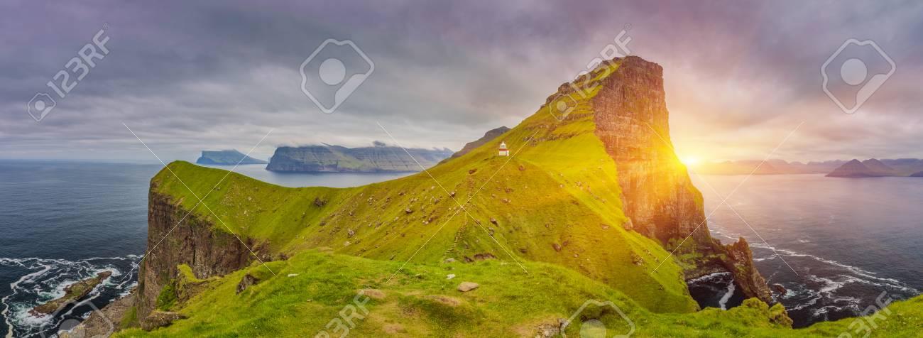 Shot Of Beautiful Panoramic Scene, Sunrise Over Kalsoy Island and Kallur lighthouse, Faroe Islands - 105398041