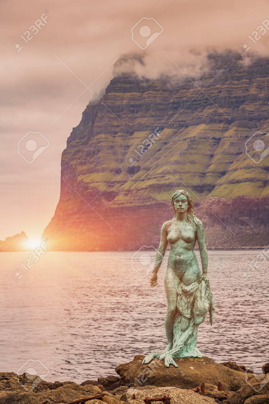 Kalsoy Island, Faroe Islands -JUNE 2018: Statue of Kopakonan (the Seal Woman), Mikladalur village, Faroe Islands - 105374095