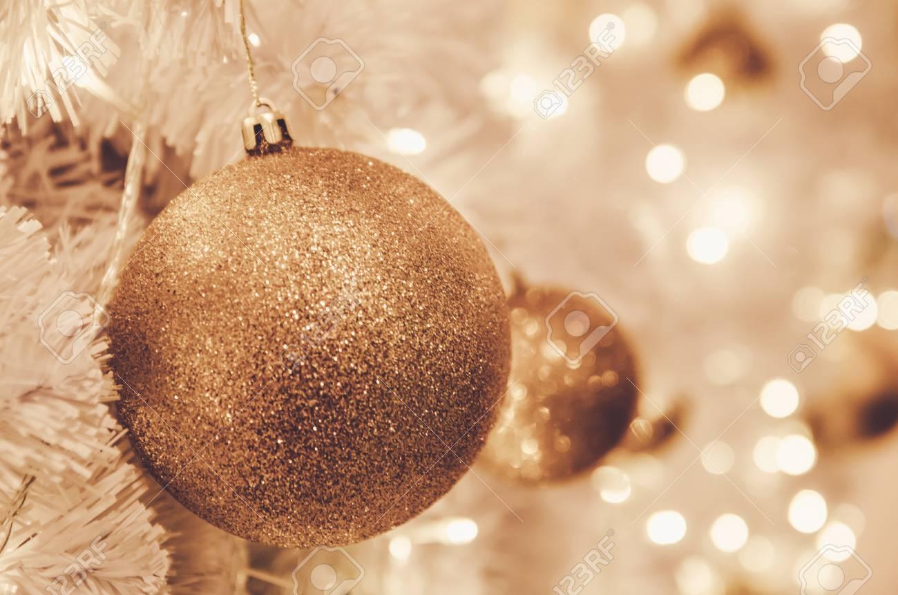 Light Bulb Christmas Ornaments.Christmas Ornaments Gold Ball And Light Bulb On Christmas Tree