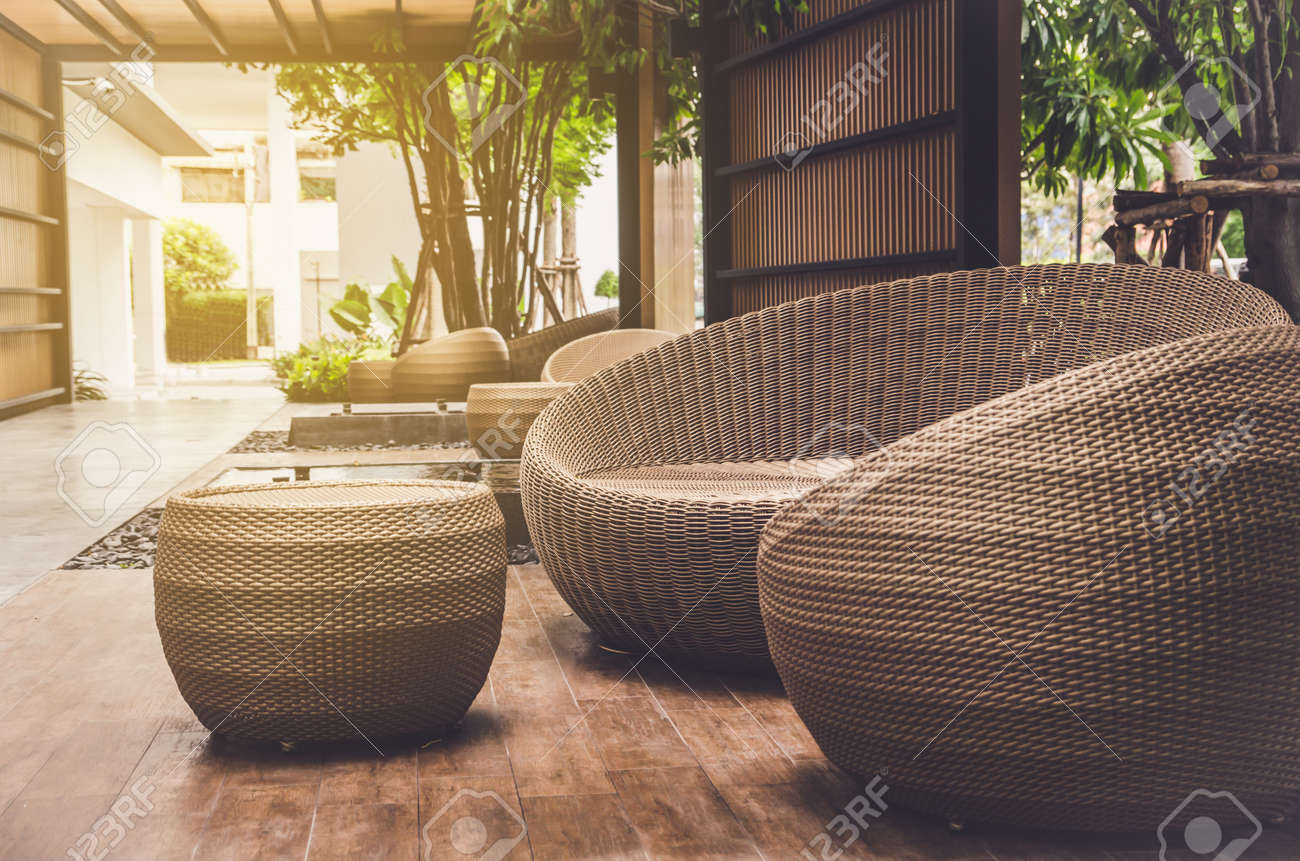 Outdoor Furniture Rattan Armchairs And Table On Terrace