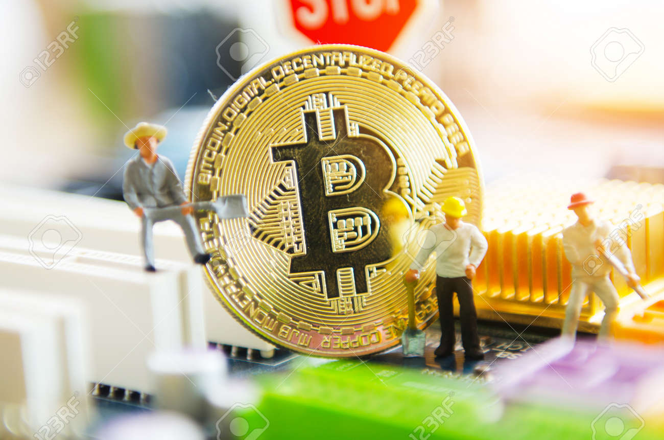 Marco Shot Of Bitcoin And Minner Worker Man Figures Working -