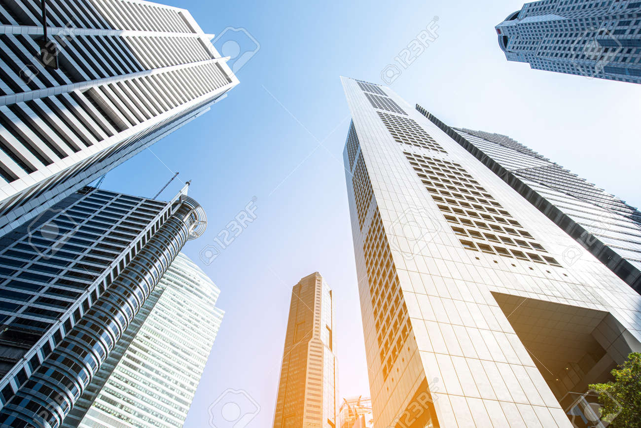 Modern business skyscrapers, high-rise buildings, architecture raising to the sky, sun. Concepts of financial, economics, future etc. - 142419373