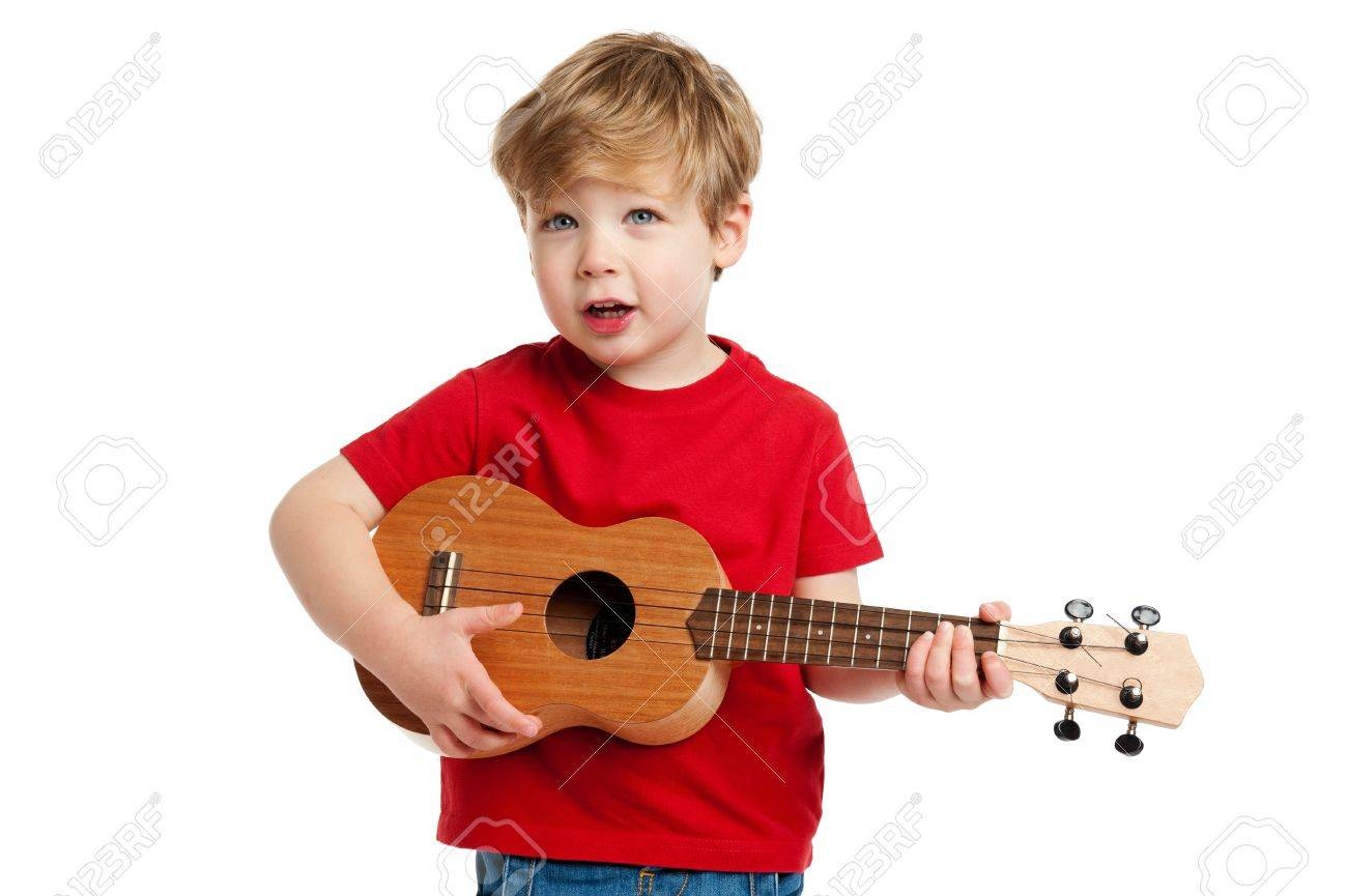 Boy singing and playing guitar shot in the studio on a white background - 19593275
